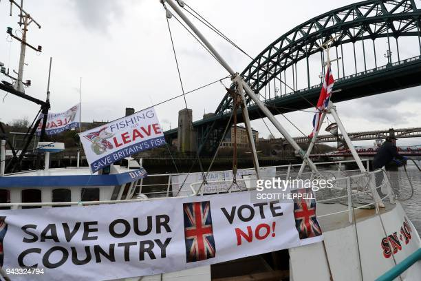 Fishing vessels are moored near the Tyne Bridge in Newcastle northeast England on April 8 during a protest against the Brexit transition deal that...
