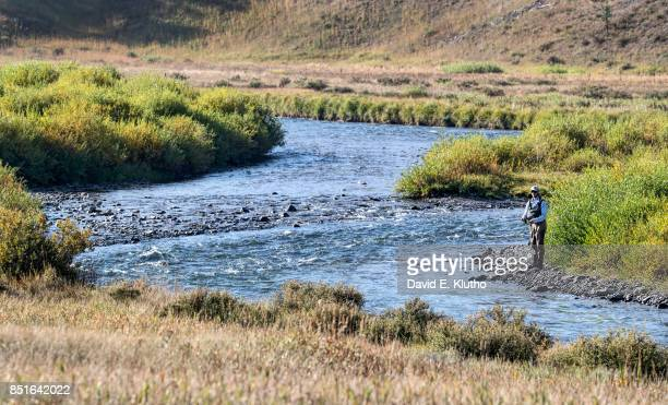 View of angler fishing on the Gallatin River outside the entrance to Yellowstone Park Bozeman MT CREDIT David E Klutho