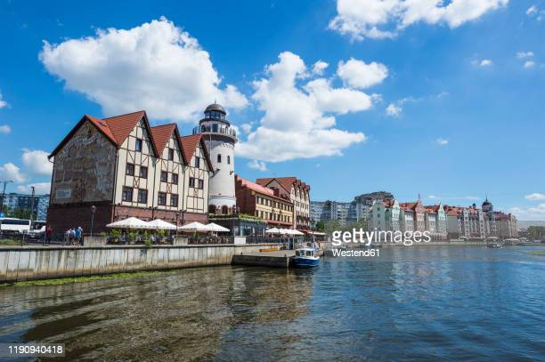 fishing village along pregel river against sky, kaliningrad, russia - kaliningrad stock pictures, royalty-free photos & images
