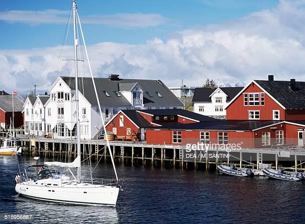 Fishing village and a sailboat Henningsvaer Austvagoy Lofoten islands Nordland county Norway