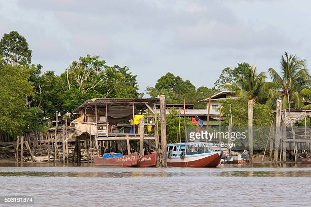 Fishing village and boats on the Suriname River