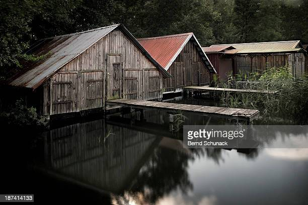 fishing village at a lake - bernd schunack stock photos and pictures