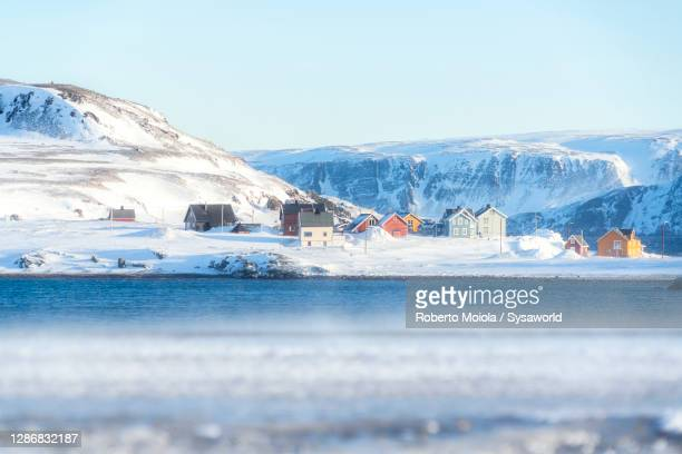 fishing village in the snow by the arctic sea, finnmark - norway stock pictures, royalty-free photos & images