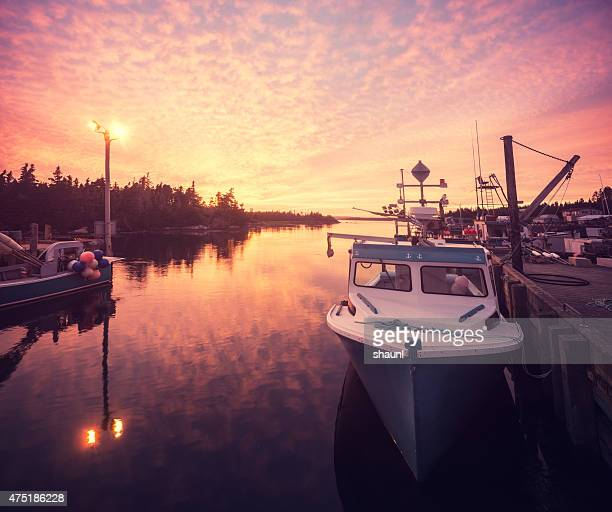 fishing village sunset - lobster fishing stock photos and pictures