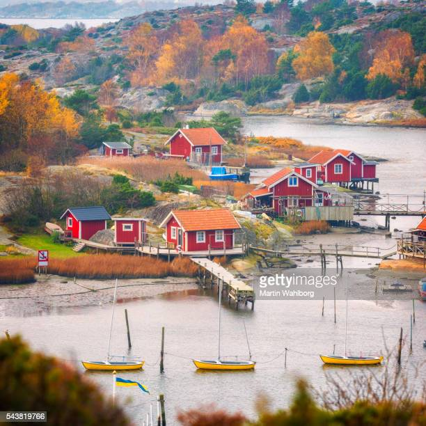 fishing village with small red cabins - northern europe stock pictures, royalty-free photos & images