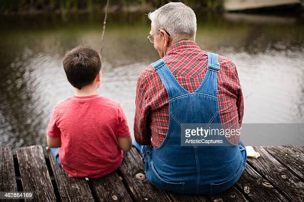 fishing with grandpa, rear view - rear view photos stock photos and pictures