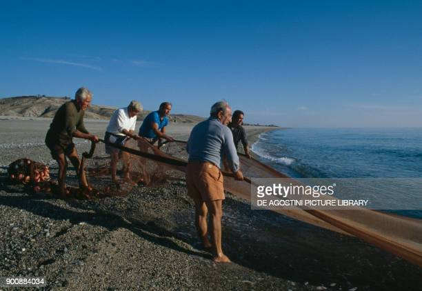 Fishing with the sciabica net on the beach of Riace Calabria Italy