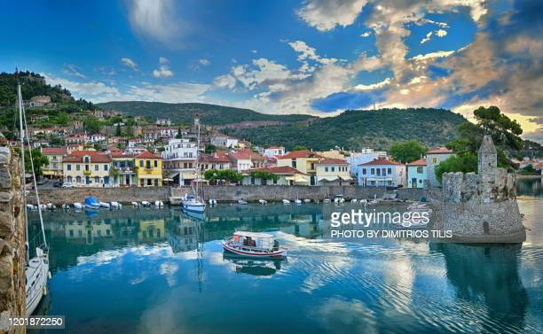 fishing-boat returns at nafpaktos - dimitrios tilis stock pictures, royalty-free photos & images