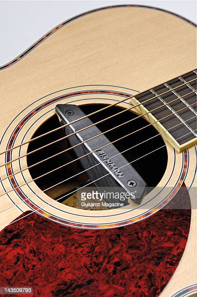 A Fishman Rare Earth Singlecoil acoustic guitar pickup fitted to the soundhole of an acoustic guitar during a studio shoot for Guitarist Magazine...