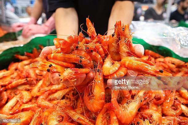 Fishmonger prepares fresh festive seafood supplies at the Sydney Fish Market on December 23 2014 in Sydney Australia The Sydney Fish Market...