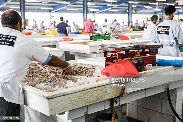 Fishmonger working at Dubai Fish Market.