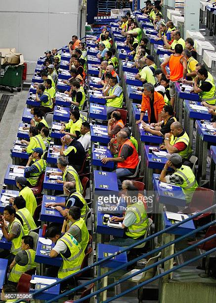 Fishmongers bid for fresh festive seafood supplies at the Sydney Fish Market on December 23 2014 in Sydney Australia The Sydney Fish Market...