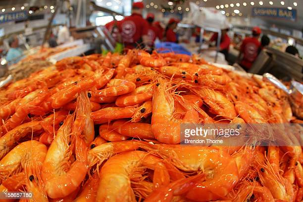 Fishmongers prepare fresh festive seafood supplies at the Sydney Seafood Market on December 23 2012 in Sydney Australia The Sydney Fish Markets...