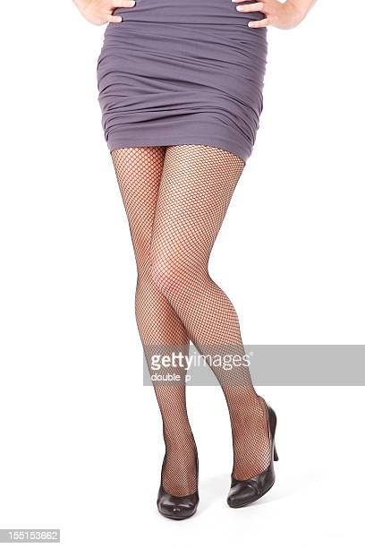 fishnet stockings - mini skirt stockings stock pictures, royalty-free photos & images