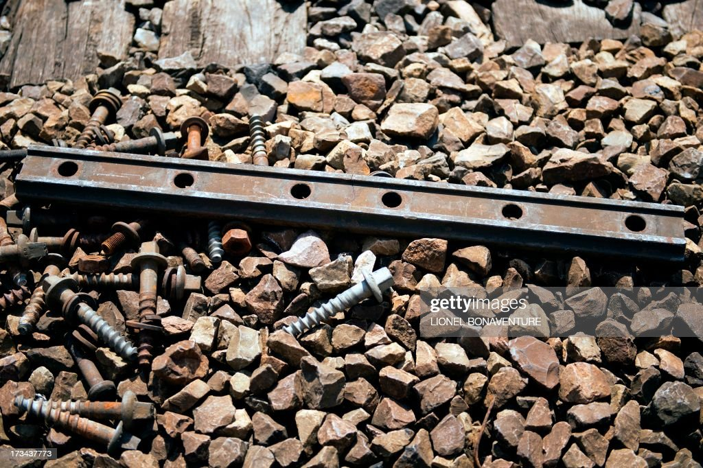 A fishplate, a metal bar which joins the ends of two rails, is pictured on July 14, 2013 in Paris at Saint Lazare railway station. A defective fishplate could be the cause of the Bretigny-sur-Orge's train accident, according to the SNCF, France's national railway company. At least six people were killed and dozens injured on July 12, 2013 after a speeding train split in two and derailed at a station in the southern suburbs of Paris.