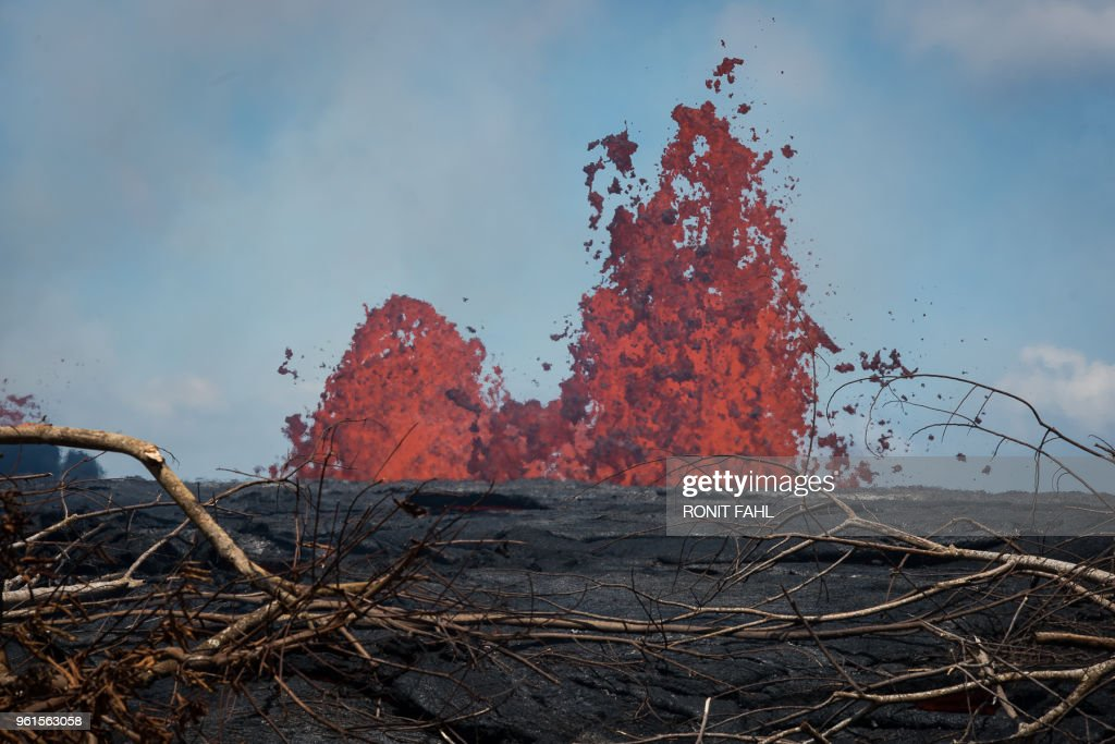TOPSHOT - Fissure #21 of the Kilauea volcano is seen on May 22, 2018 in the Leilani Estates subdivision of Pahoa, Hawaii. - Authorities in Hawaii have warned of dangerous 'laze' fumes as molten lava from the erupting Kilauea volcano reached the Pacific Ocean. Two lava flows 'reached the ocean along the southeast Puna coast overnight,' on Hawaii's Big Island, the US Geological Survey, which monitors volcanoes and earthquakes worldwide, said in a statement May 20, 2018.
