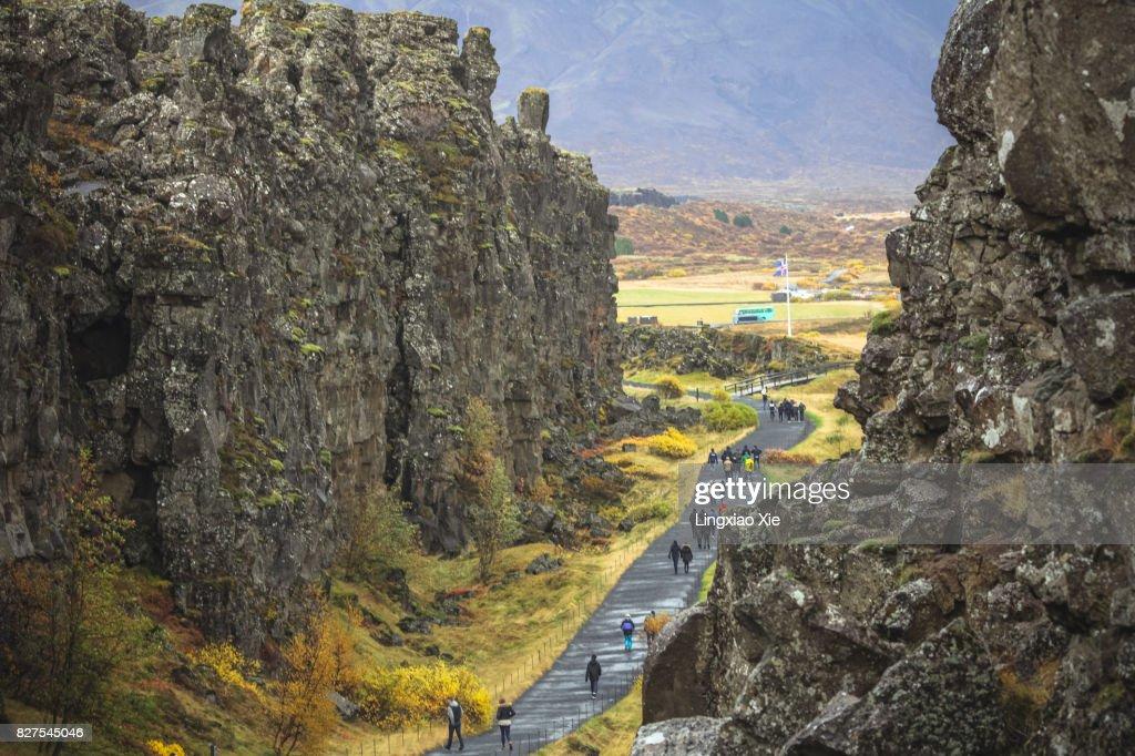 Fissure zone with Iceland Flag at Thingvellir National Park, Iceland : Stock Photo