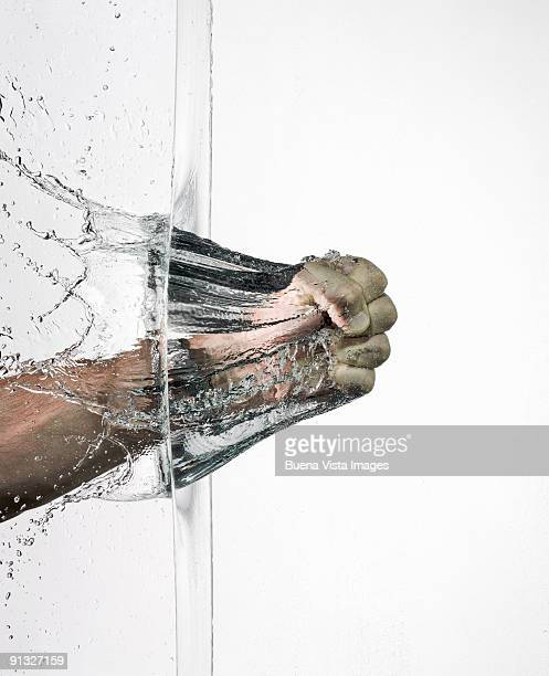 fist braking a water wall - appearance stock pictures, royalty-free photos & images