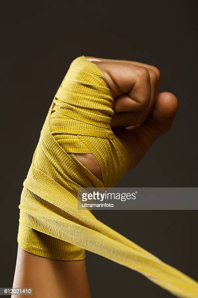Fist Female kickboxing  Athletic woman wrapping hands with boxing wraps