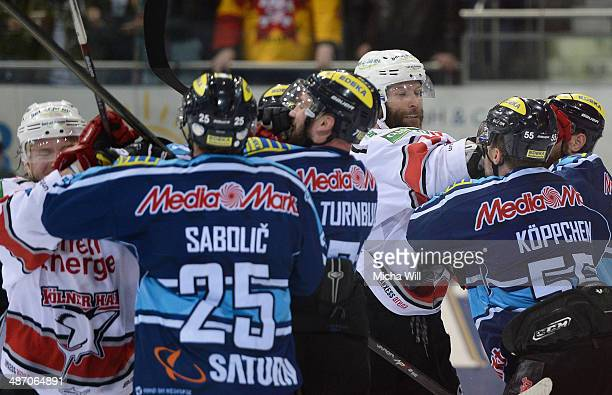 A fist fight is seen in game six of the DEL final playoffs between ERC Ingolstadt and Koelner Haie at Saturn Arena on April 27 2014 in Ingolstadt...