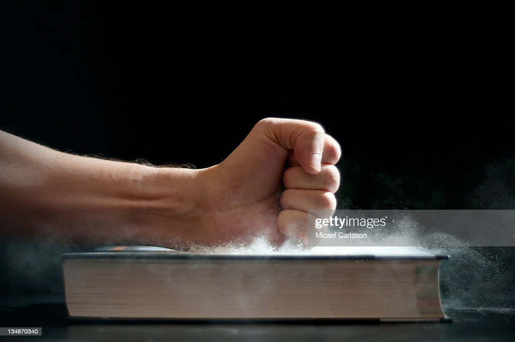 Fist hits book : Stock Photo