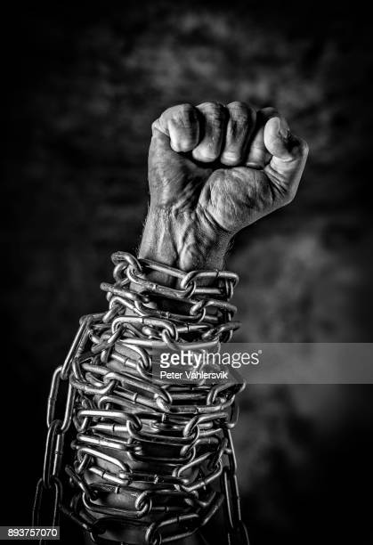 fist in chains - domination stock pictures, royalty-free photos & images
