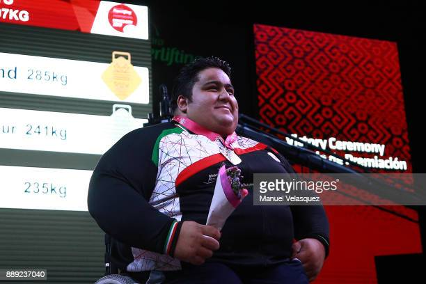Fist Place Siamand Rahman of Iran celebrates with his medal during the Men's Over to 107 Kg Group A Category as part of the World Para Powerlifting...