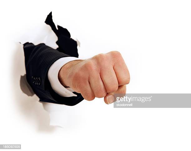 fist punch through white paper - appearance stock photos and pictures