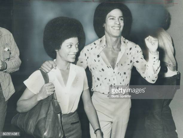 Fist raised in BlackPower salute Black Panthers founder Huey Newton talks to reporters last night with his wife Gwen at his side He had spent two...