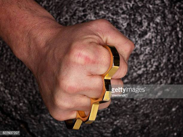 Fist with brass knuckles