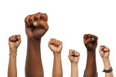 Fists and Arms raised in unison against white