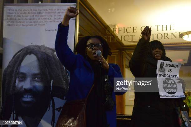 Fists are raised as activists Megan Malachi with two dozen others rally outside the District Attorneys Office in Philadelphia PA on December 12 2018...