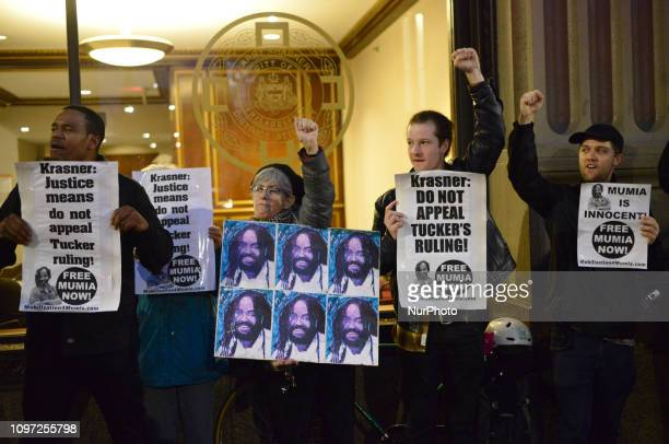Fists are raised as activists rally outside the District Attorneys Office in Philadelphia PA on December 12 2018 to call on DA Larry Krasner to not...