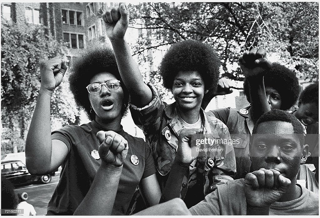 Fists in the air, attendees smile at the Revolutionary People's Party Constitutional Convention, Philadelphia, Pennsylvania, early September 1970.