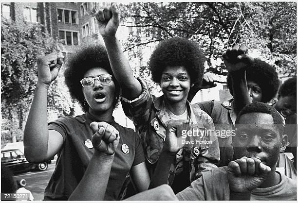 Fists in the air attendees smile at the Revolutionary People's Party Constitutional Convention Philadelphia Pennsylvania early September 1970