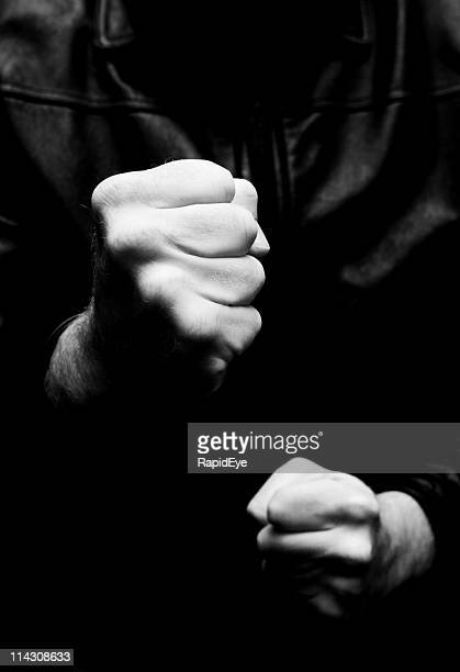 fists (bw version) - anti bullying symbols stock pictures, royalty-free photos & images