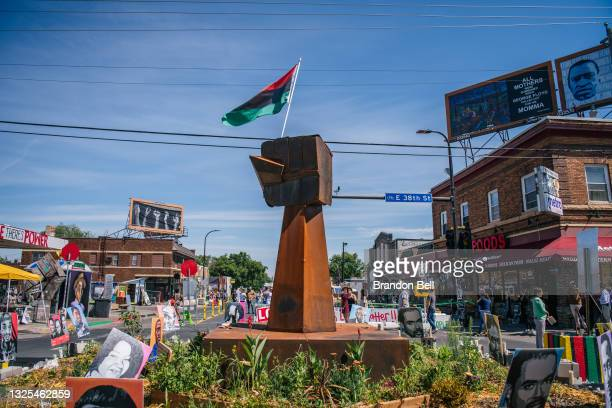 Fist-shaped monument sits in the intersection of 38th Street and Chicago Avenue, ahead of former Minneapolis police officer Derek Chauvin's...
