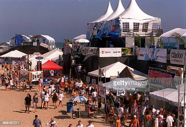 Surf.Village.RH––072598––A look from the Huntington Beach Pier shows the many banners, ads, and people at the sponsor village during the G–Shock U.S....