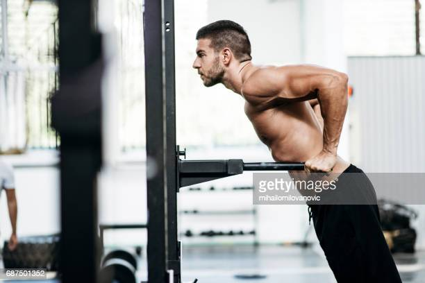 Fit and sexy men doing dips
