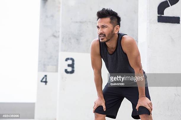 Fit Asian Male Taking an Exercise Break