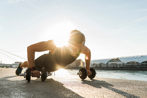 Fit athlete doing push ups at the river - gettyimageskorea