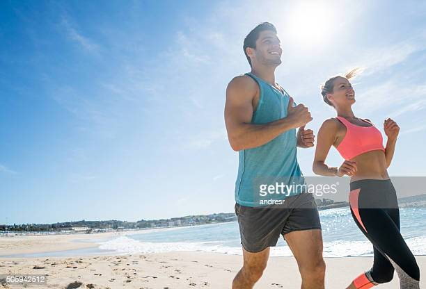 Fit couple running at the beach