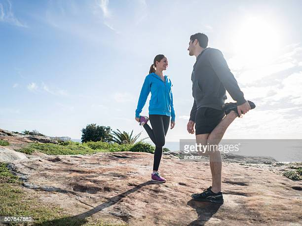 Fit couple stretching before going for a run