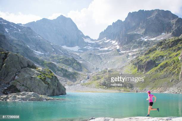 fit female running in the mountains - auvergne rhône alpes stock photos and pictures