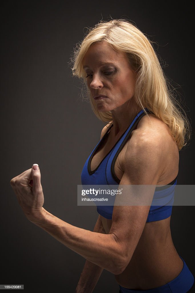 Fit Fifty Year Old Woman Working Out High-Res Stock Photo