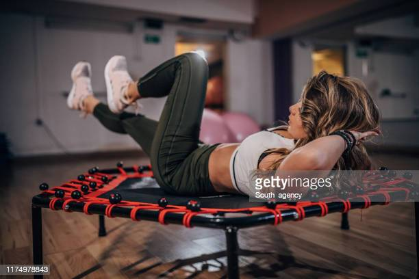 fit lady training in gym - styles stock pictures, royalty-free photos & images