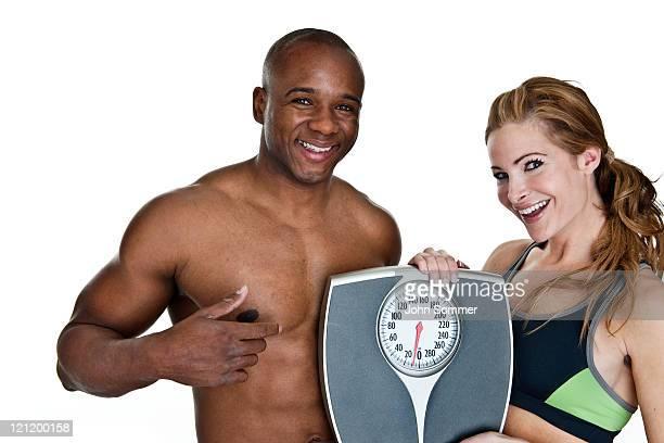 フィット感の男性と女性の健康を押しスケールコンセプト