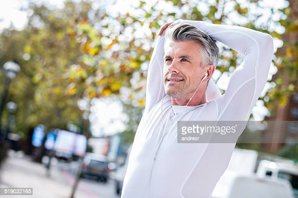 Fit man stretching