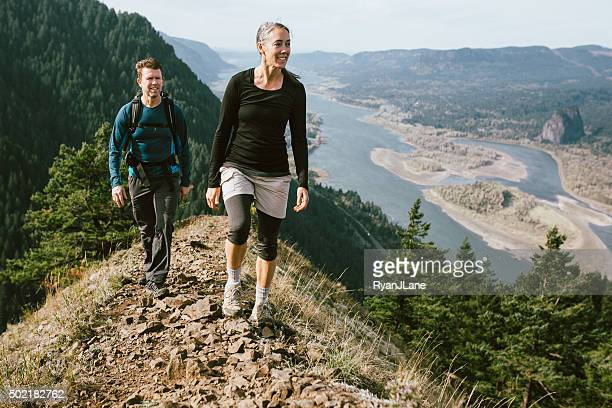 fit mature adults on mountain hike - columbia river gorge stock pictures, royalty-free photos & images