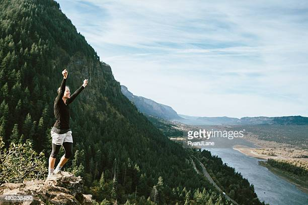 fit mature woman at mountain viewpoint - columbia river gorge stock pictures, royalty-free photos & images